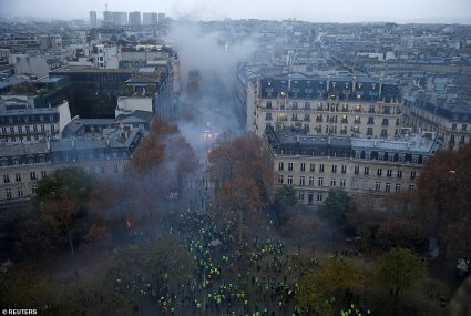 6884492-6451503-This_picture_taken_from_the_top_of_the_Arc_de_Triomphe_shows_a_s-a-63_1543779676712